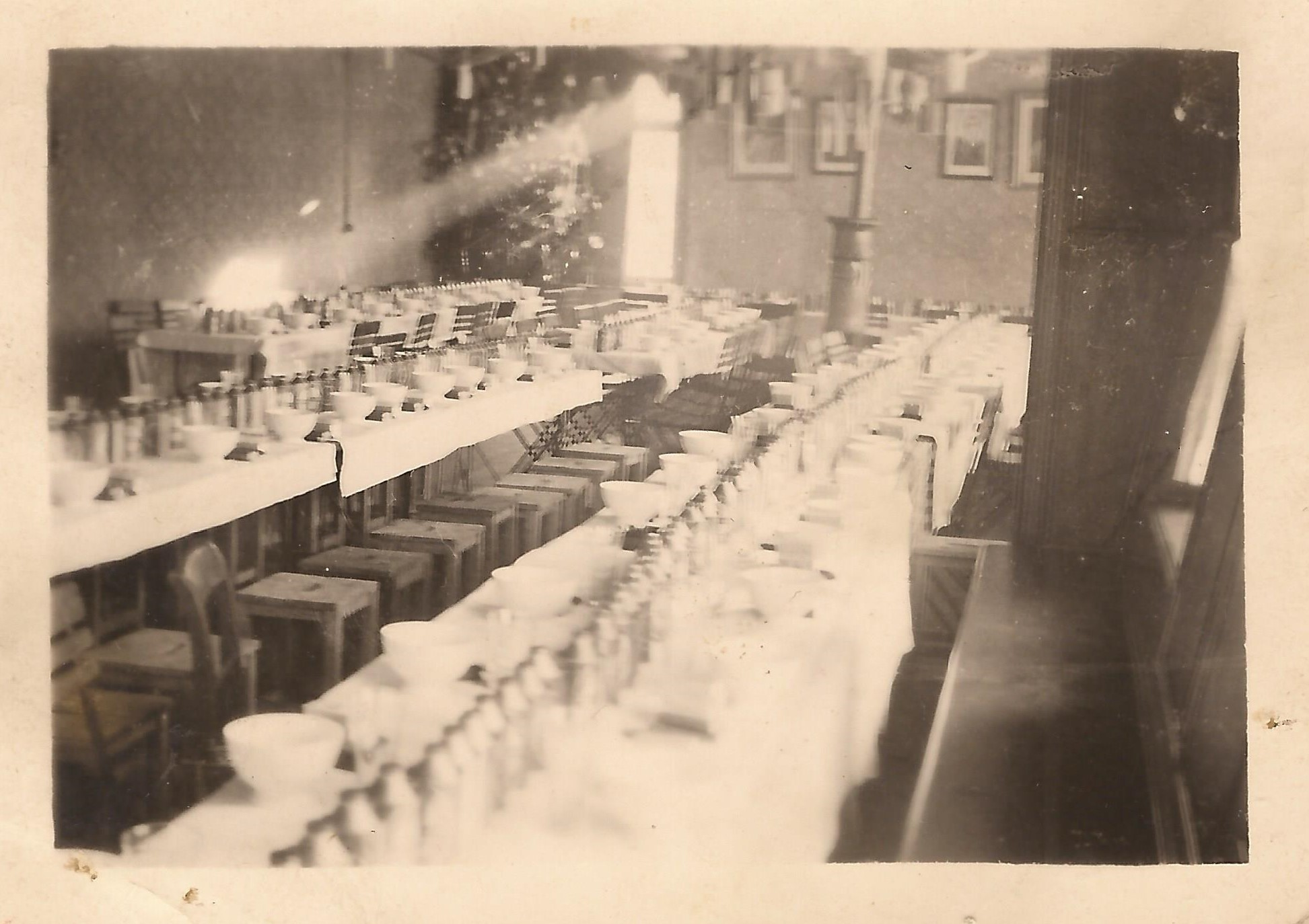 21 January 1945 - Christmas at Bree,  table ready for dinner, including Christmas tree and plenty of tins of English beer - Fruin Collection