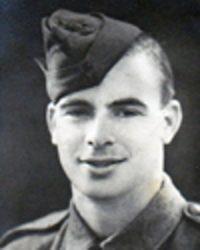 Cpl. Birleson, wearing other rank's rifle green (dark green) side cap.