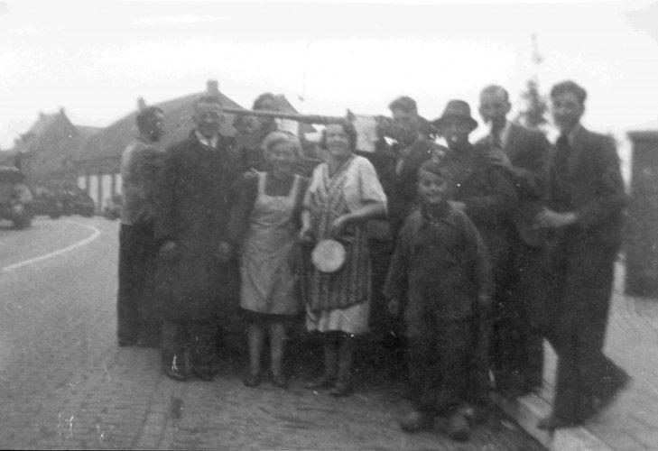 Civilians in front of Bren carrier - Van der Sanden coll.