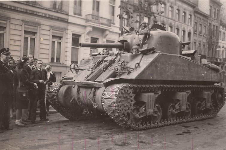 Sherman. Note driver's American type tank helmet - editor's collection