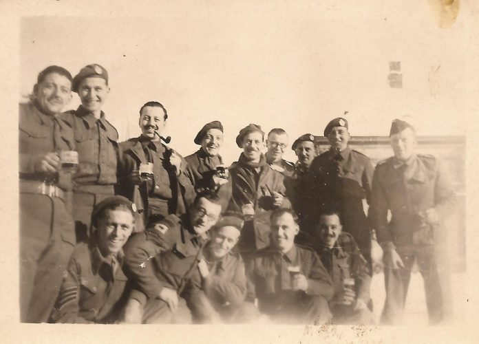 N017 - Kneeling, extreme left, Sgt. 'Tiny' Baldwin, G Company - Sgt. Fruin collection