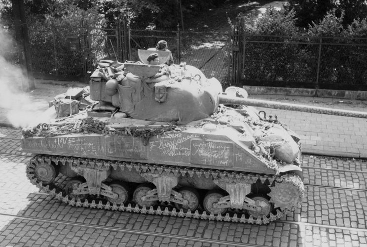 23rd Hussars Sherman. Note 'Mechelen' written on side, to rear, and camouflage of gun barrel, Antwerpsestraat, Mortsel - Kenny collection