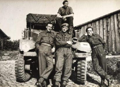 Rfn. Heron (left) and three fellow riflemen in front of half track - Rfn. Heron coll.