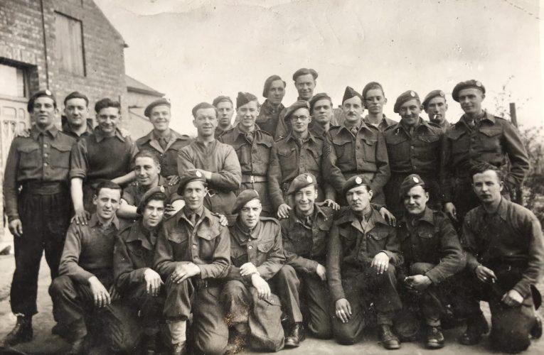 N049 - E Coy group. Rfn. Heron, kneeling extreme left, Rfn. Batkin, standing 3rd from right - Rfn. Heron collection