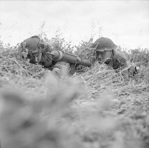 Rilfeman Reg Oates and Sergeant James Woodward of 6 Platoon, F Company, with PIAT (Projector Infantry Anti Tank), Operation Epsom, 29 June 1944.
