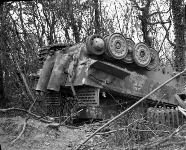 Tiger tank turned upside down by the bombardment.